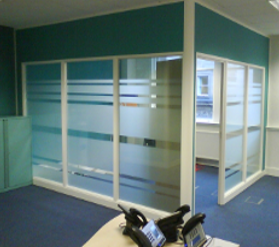 glass manifestation installed on glass walls of office